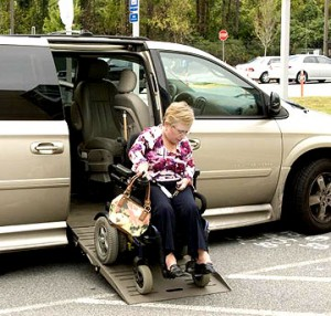 Woman exiting a van in a wheelchair