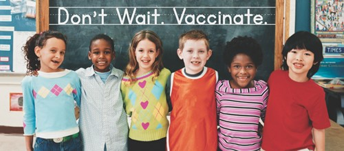 Kids with Don't Wait Vaccinate message on chalkboard.